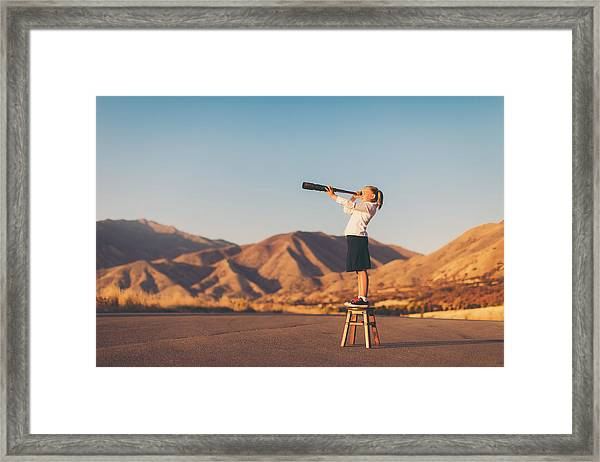 Young Business Girl Looks Through Telescope Framed Print by RichVintage