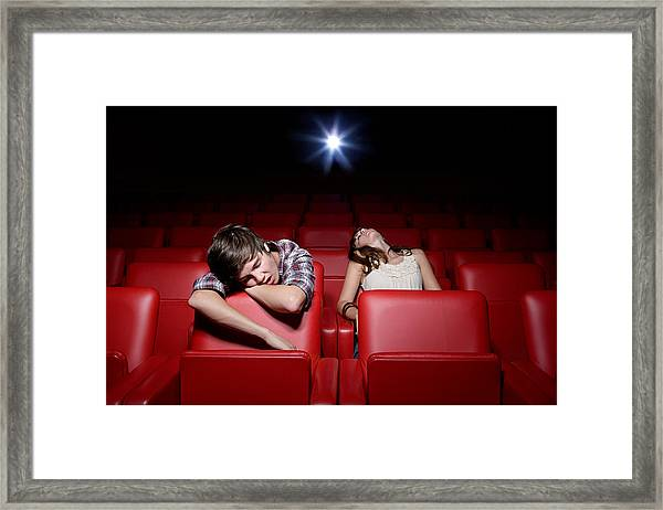 Young Couple Asleep In The Movie Theater Framed Print by Image Source