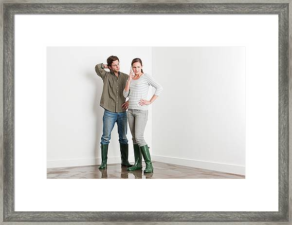 Young Couple On Flooded Floor Framed Print by Image Source