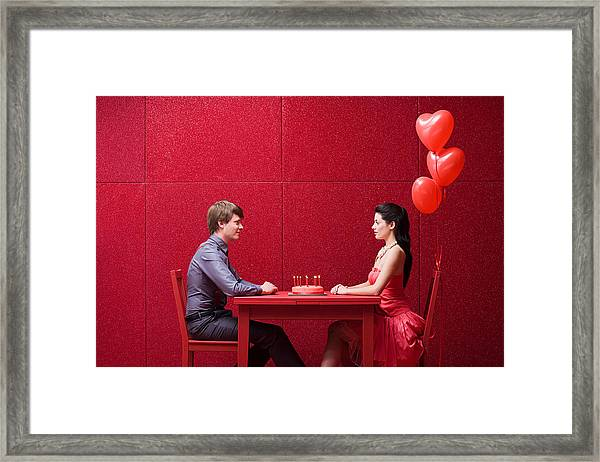 Young Couple With Cake Framed Print by Image Source
