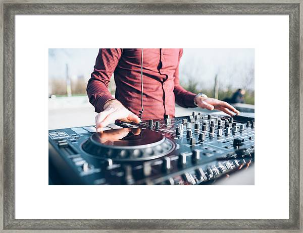 Young Man Using Mixing Desk At Roof Party, Mid Section, Close-up Framed Print by Eugenio Marongiu
