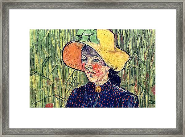 Young Peasant Girl In A Straw Hat Sitting In Front Of A Wheatfield Framed Print