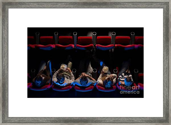 Young People Sitting At The Cinema Framed Print by Stock-asso