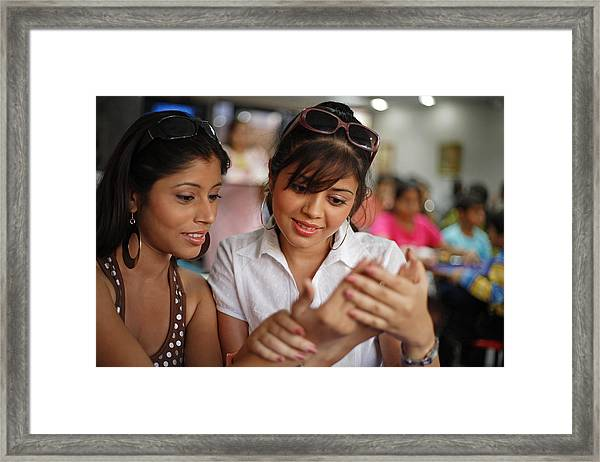 Young Woman Having Palm Read Framed Print by Visage