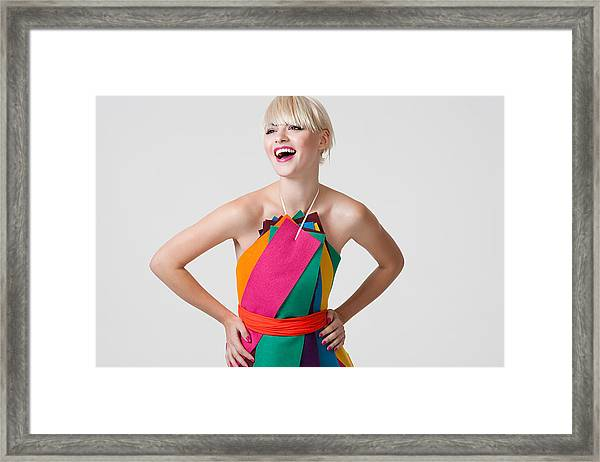 Young Woman In Dress Made Of Coloured Ribbons Framed Print by Image Source