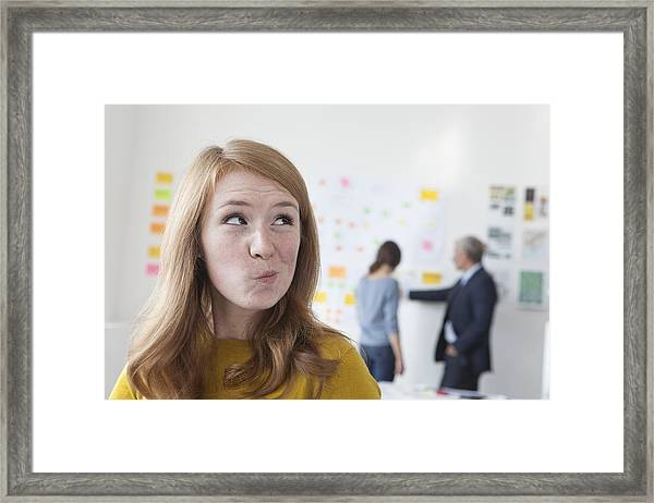 Young Woman In Office Thinking Framed Print by Westend61