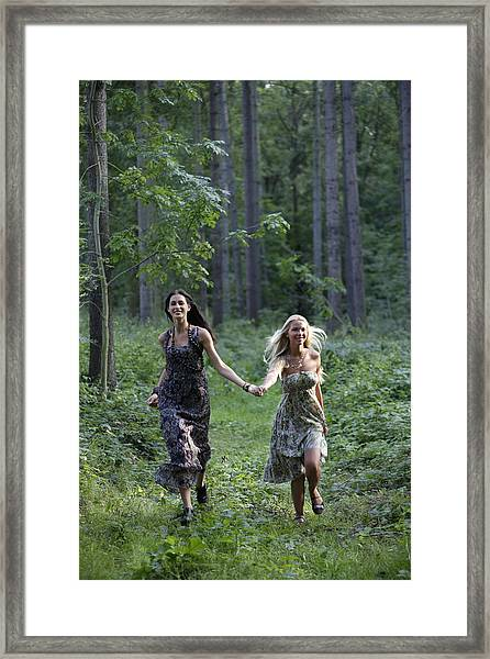 Young Women Running Through Forest Framed Print by Asia Images