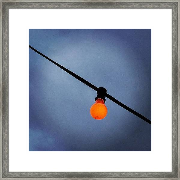 Orange Light Bulb Framed Print