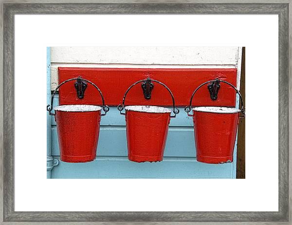 Three Red Buckets Framed Print