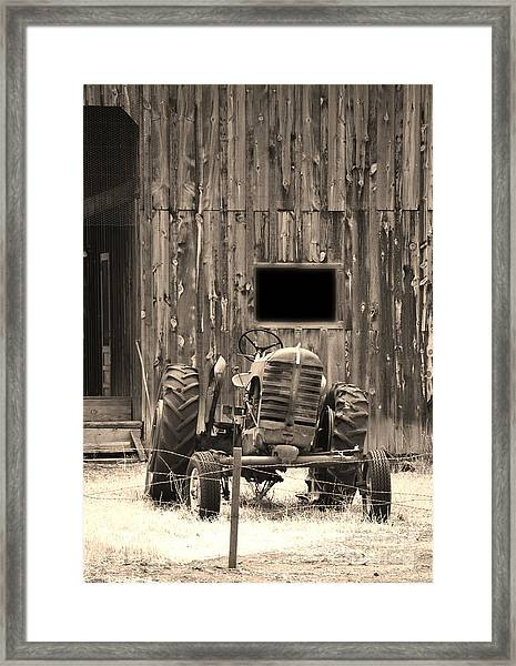 Tractor And The Barn Framed Print