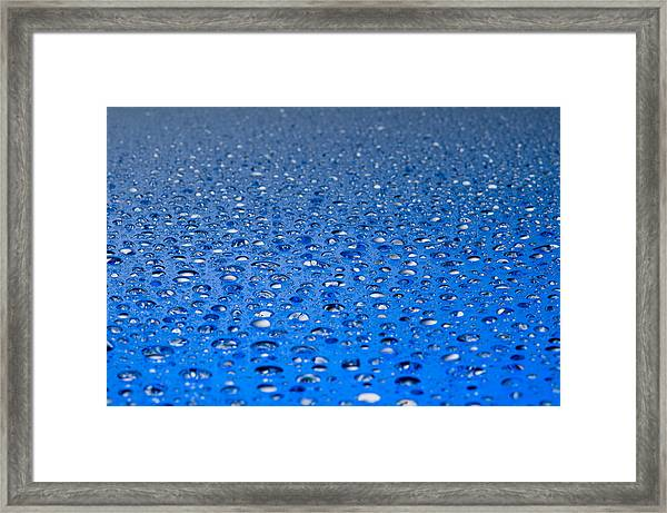 Water Drops On A Shiny Surface Framed Print