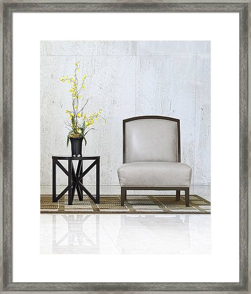 A Chair And A Table With A Plant  Framed Print