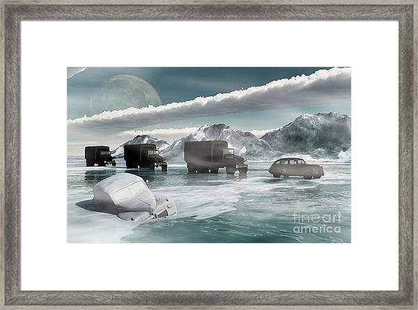 A Convoy Of Military Vehicles Traveling Framed Print