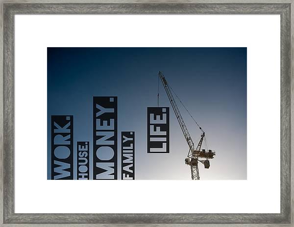 A Crane Lifting The Word Life Framed Print