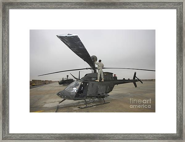 A Crew Chief Peforms Maintenance Framed Print