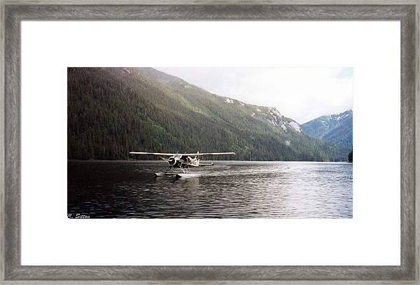 Airplane On Lake Framed Print