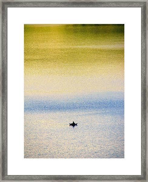 Alone On The Lake Framed Print