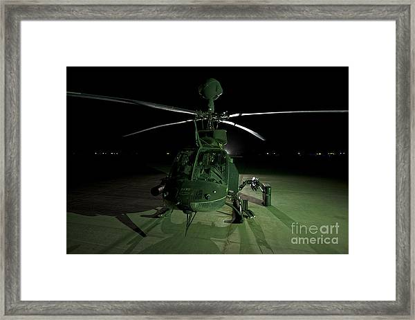 An Oh-58d Kiowa Helicopter At Cob Framed Print