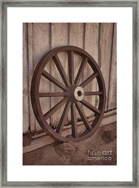 An Old Wagon Wheel Framed Print