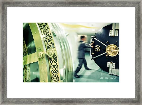 Banker Is Opening Safe Door Framed Print