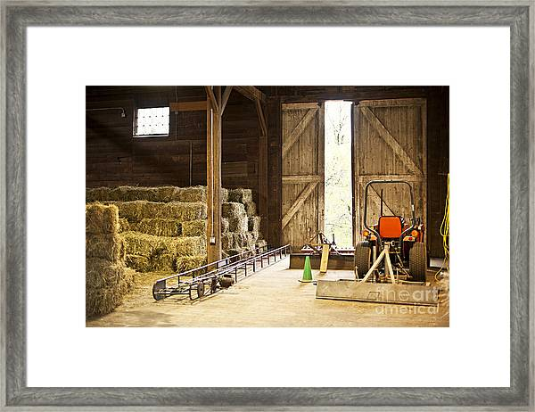 Barn With Hay Bales And Farm Equipment Framed Print