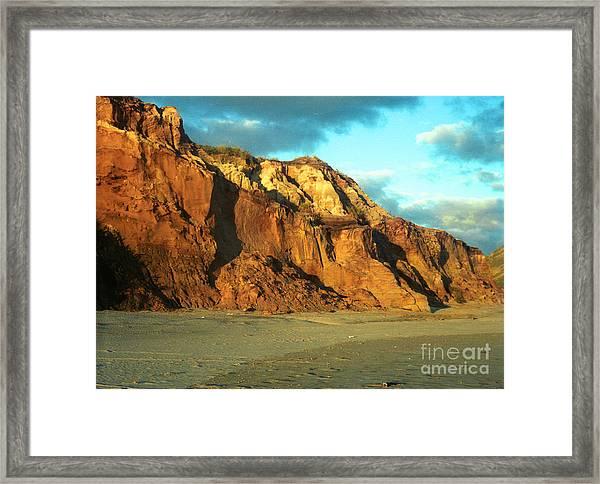 Beach Cliff At Sunset Framed Print