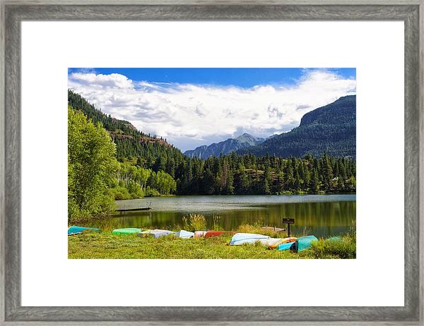 Boat Lined Lake Framed Print