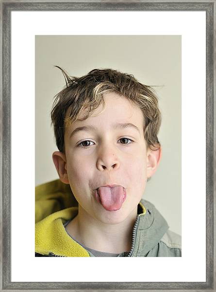 Boy Pokes His Tongue Out Framed Print