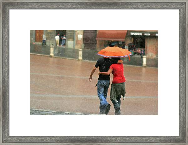 Braving The Rain Framed Print