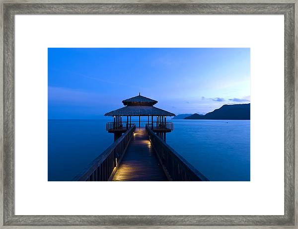 Building At The End Of A Jetty During Twilight Framed Print