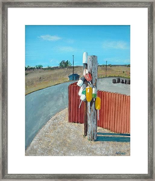 Buoys On A Pole Framed Print