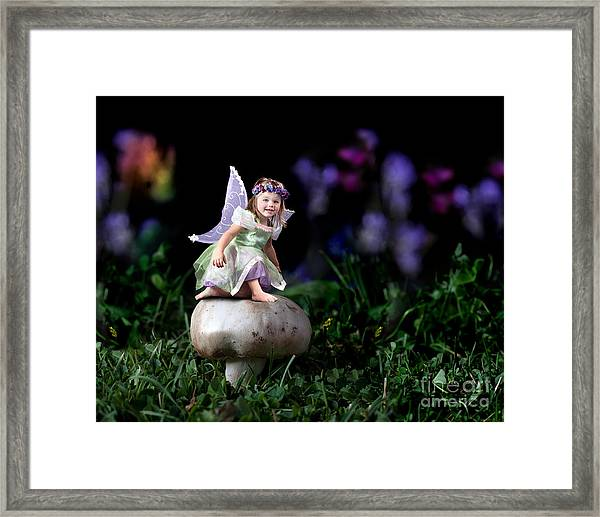 Child Fairy On Mushroom Framed Print