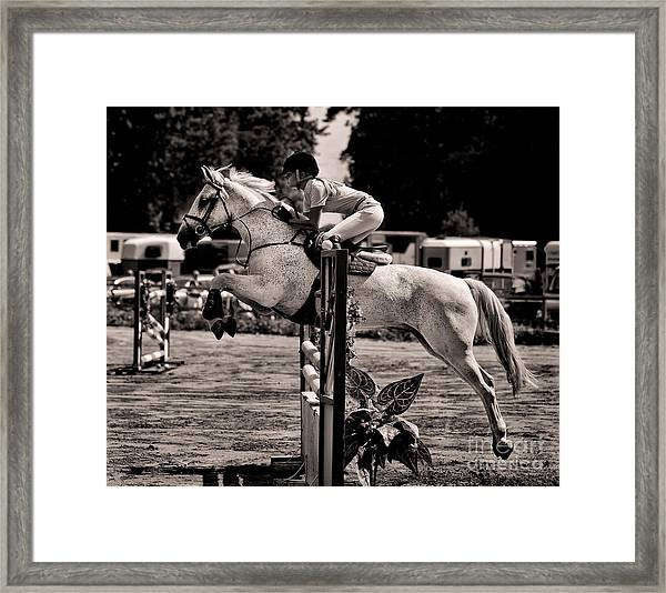 Clearing The Hurdle Framed Print