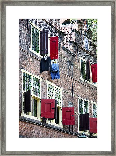Clothes Hanging From A Window In Kattengat Framed Print