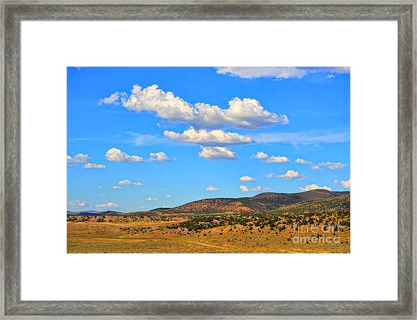 Cloudy Wyoming Sky Framed Print