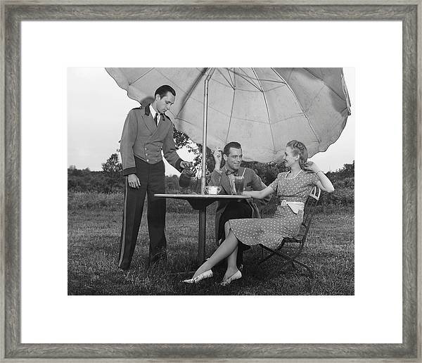 Couple Being Served By Waiter Framed Print
