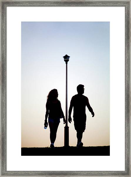 Couple Exercise While Walking At Sunset Framed Print