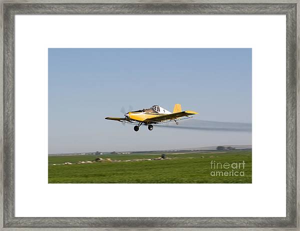 Crop Duster Flying Over Farm  Framed Print