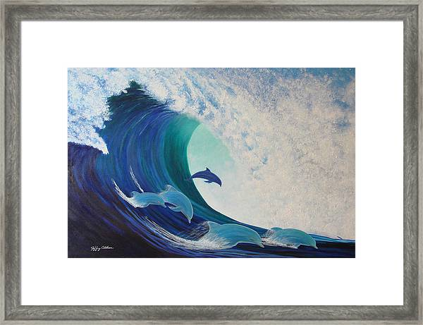 Dolphin Wave Framed Print by Jeffrey Oldham