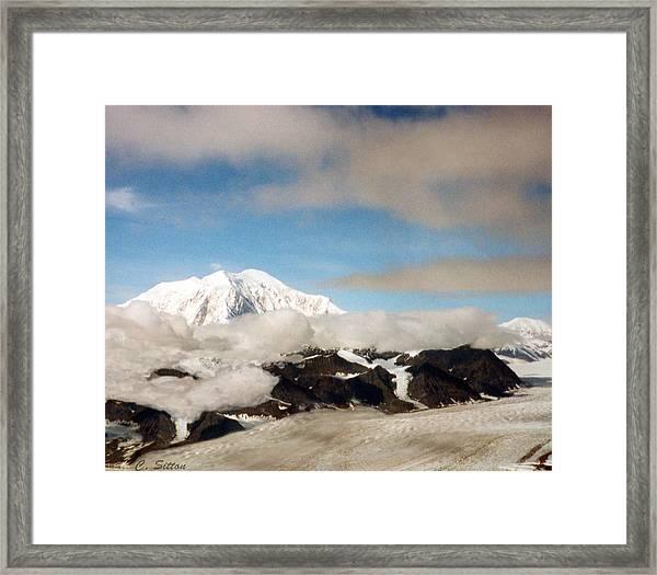 Glacier In The Clouds Framed Print