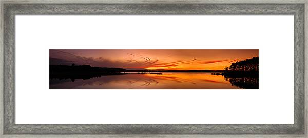 Golden Sunset Panorama On A Quiet Lake Framed Print by Sebastien Coursol
