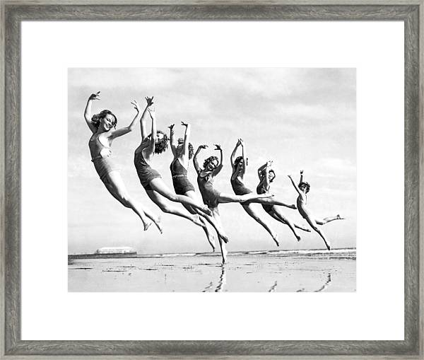 Graceful Line Of Beach Dancers Framed Print