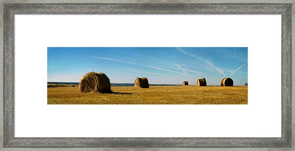 Haybales And Jet Trails Framed Print