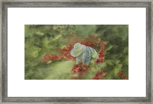 In Her Garden Framed Print