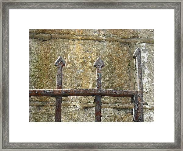 Iron Spikes Framed Print