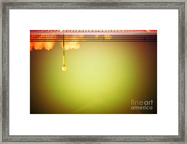 Lamp And Clouds In A Swimming Pool Framed Print