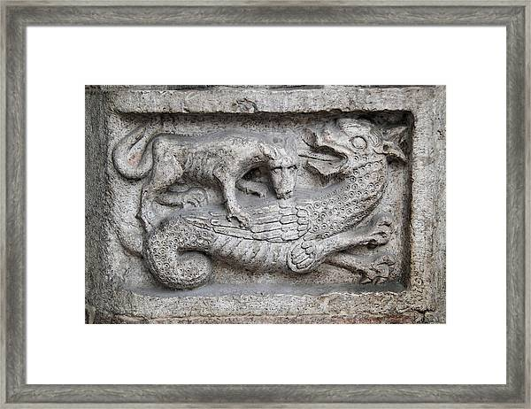 Lion And Dragon Framed Print