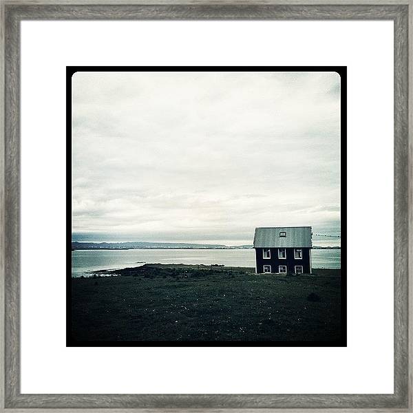 Little Black House By The Sea Framed Print