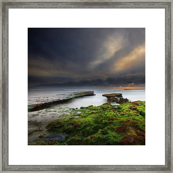 Long Exposure Of A Stormy Sunset At A Framed Print by Larry Marshall