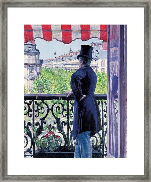 Man On A Balcony On Boulevard Haussmann Framed Print